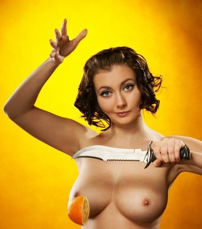 The girl with a knife and an orange photo