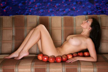 girl with apples on a sofa photo