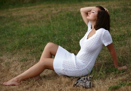 The beautiful girl on a green grass Stock Photo - 13465709