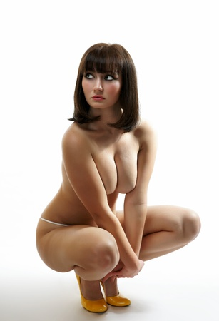 The undressed girl on a white background Stock Photo