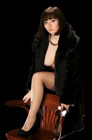 Het sexy meisje in een bontjas