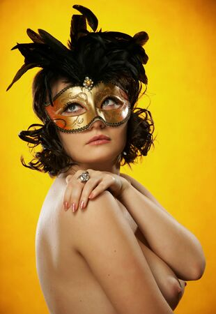 The sexy girl in a mask Stock Photo - 13465470