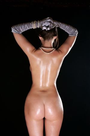 The bared girl in gloves