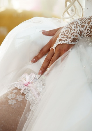 corrects: The bride corrects a garter