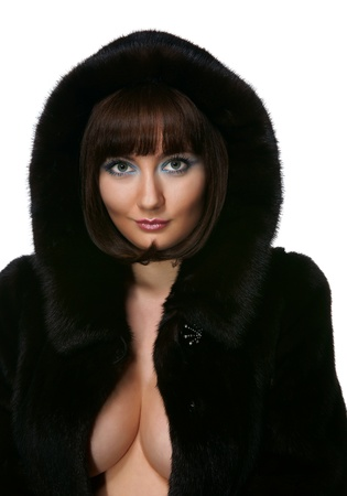 The sexy girl in a fur coat on a white background photo