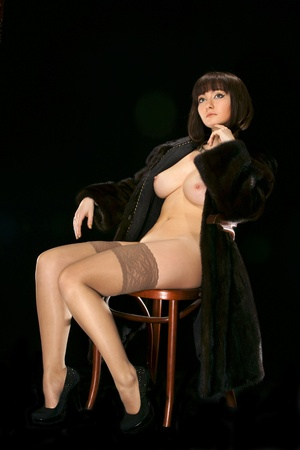 The sexy girl in a fur coat