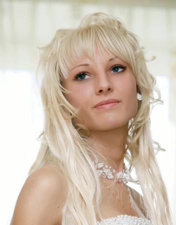 Beautiful Blond bride wearing photo