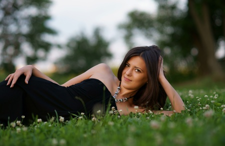 The beautiful girl on a green grass photo