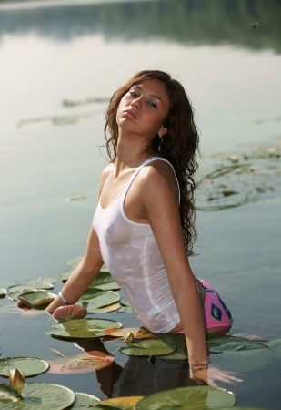 The sexual girl in a wet vest Stock Photo - 13540883