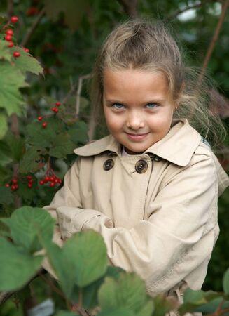 guelderrose: The little girl in guelder-rose bushes