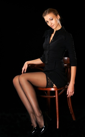 The beautiful girl in stockings on a chair Stock Photo