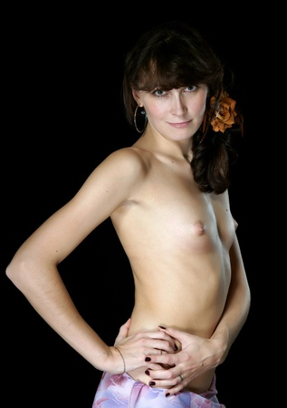 The naked girl on a black background.