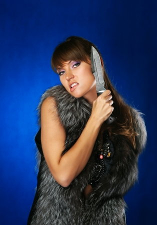 portrait of the brunette with a hunting knife photo