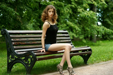 The girl on a bench photo
