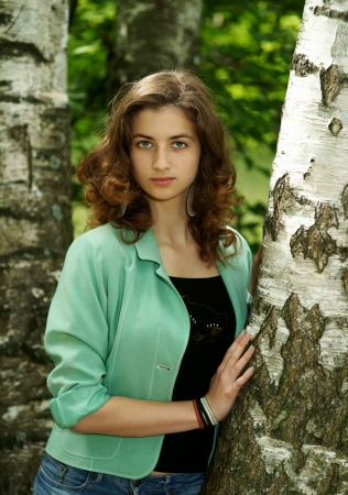 The beautiful girl near birches photo