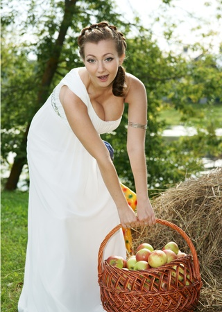 the bride with a basket of apples photo
