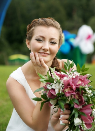 The bride with a bunch of flowers photo