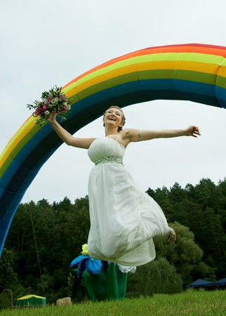 The happy bride in a jump photo