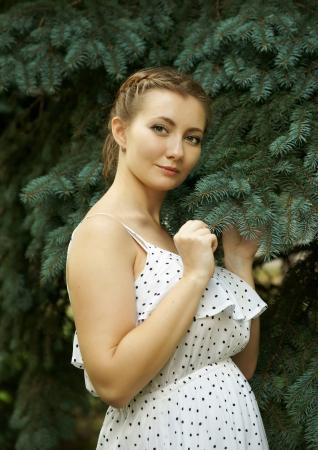 The girl near a fir-tree photo