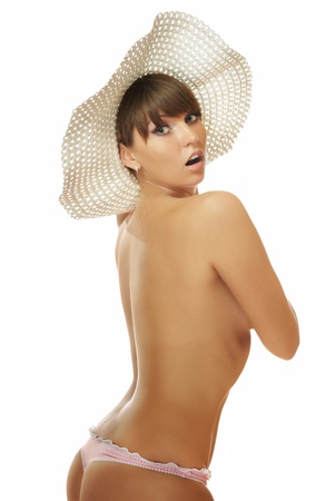 The nude brunette in a hat photo