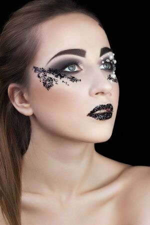 shards: Girl with  creative Makeup with Pearls and Shards on black background Stock Photo