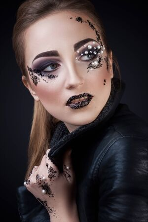 shards: Girl in jacket with  creative Makeup with Pearls and Shards on black background