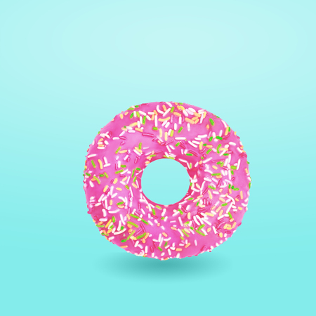 Pink donut with icing on blue background. Glazed donut. Top view. Minimal concept.