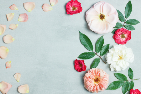 Festive flower composition on gray background. Top view. Overhead. Flower pattern. Head of roses