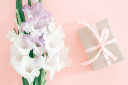 Gladiolus flowers on pink background. Flat lay style with copy place for text. Festive card Stock fotó - 118442512