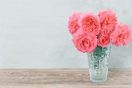 Beautiful rose flowers in pink vase. Greeting card for Womens day or Mothers day. Romantic background