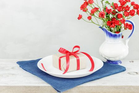 Empty plate on tablecloth or napkin on wooden table over cement grunge background. table setting