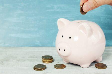 Piggy bank money on table on gray background. Savings concept. Stock fotó