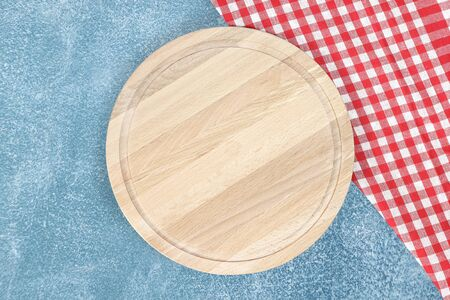 Cutting board or chopping board on stone table. Wooden plate on dark desk. Top view