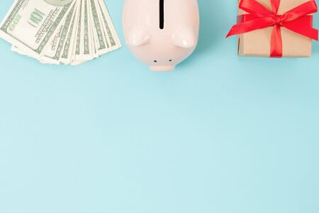 Piggy bank money on blue background. Savings concept. Top view. Flat lay Stock fotó