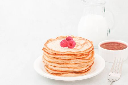 Classic american pancakes with raspberries jam, morning on white background copy space top view Stock fotó