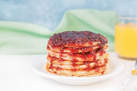 Pancakes with jam on plate on table. Stack of pancakes for breakfast. Maslenitsa. Food background. Stock fotó