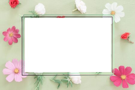 Beautiful flower heads on mint background. flower in pastel colors. overhead view, top view. Greeting card for female, valentine, birthday day with copy space