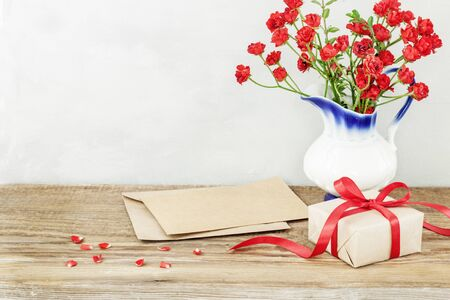 Present or gift box in a craft paper  red rose. Greeting card for Valentines or Mother Day. Stock fotó