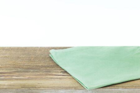 Napkin or tablecloth on wooden table. Copy space