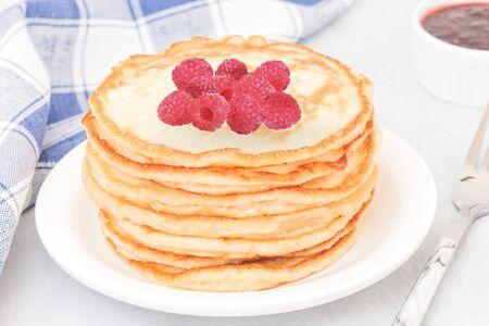 Classic american pancakes with raspberries jam