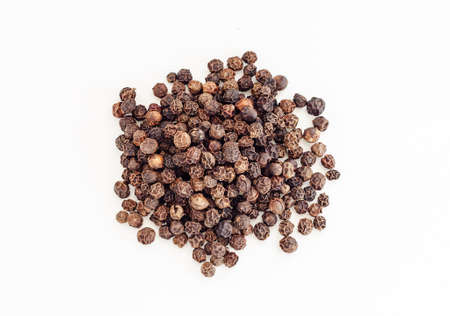 Small pile of black pepper isolated on white background. Top view. (dried seeds of Piper nigrum). Peppercorns, Black peppercorn