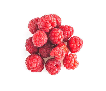 Heap of Ripe raspberries with green leaf isolated on white background. Red berry Top view