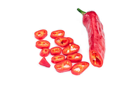 Set of whole and chopped red Hungarian Hot Wax pepper or paprika (Capsicum annuum). Chili pepper