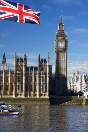 Big Ben with flag and boat, London, UK  photo
