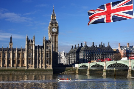 england politics: Big Ben with flag and boat, London, UK