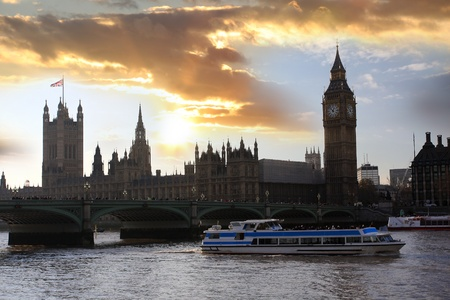 Big Ben with city cruise in  London, UK photo