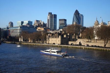 Modern London with city cruise, England  photo