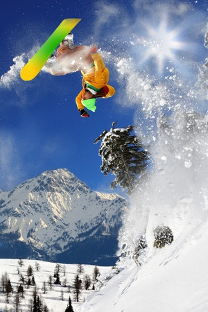 Snowboarders jumping against blue sky  Stock Photo - 12021212