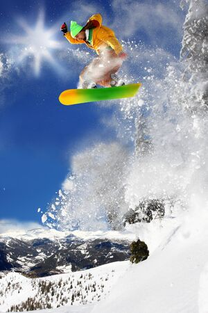Snowboarders jumping against blue sky Stock Photo - 12021340