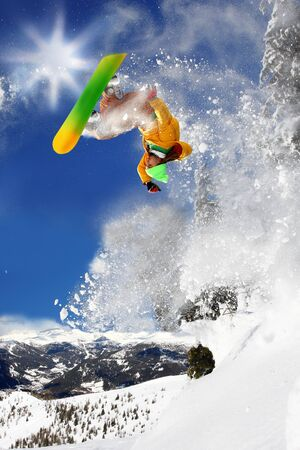 Snowboarders jumping against blue sky  Stock Photo - 12021349